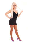 Pretty girl in black short dress. Stock Photo