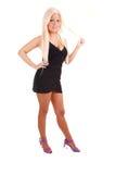 Pretty girl in black short dress. Stock Photo