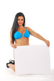 Pretty girl with blank notice board Stock Photography