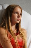Pretty girl with blond hair. Attractive young female teenager with long blond hair and red blouse Stock Images
