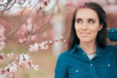 Beautiful Smiling Woman Near Pink Blooming Spring Tree Royalty Free Stock Image