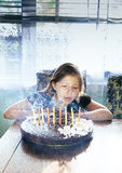 Pretty girl blowing the candles on the cake Royalty Free Stock Photography