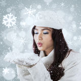 Pretty girl blowing snow on the hands Stock Photos