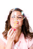 Pretty girl blowing soap bubbles Royalty Free Stock Images