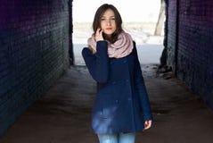 Pretty girl in blue coat on plein air royalty free stock photos