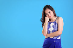 Pretty girl in blue with copy space Stock Photography