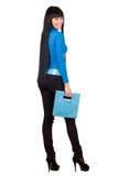 Pretty girl with a blue handbag Royalty Free Stock Image