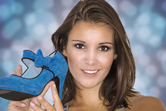 Pretty girl with a blue shoe Royalty Free Stock Images