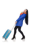 Pretty girl in blue winter jacket with suitcase Royalty Free Stock Image