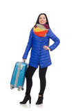 Pretty girl in blue winter jacket with suitcase Stock Images