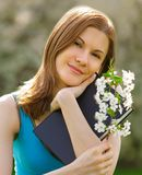 Pretty girl with a book outdoors Stock Photo
