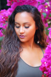 Pretty girl in Bougainvilleas Royalty Free Stock Photography