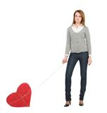 Pretty girl with bounded heart Stock Images
