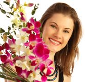 Pretty girl with a bouquet. Isolated on white Stock Photography