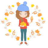 Pretty girl with a bouquet of leaves Royalty Free Stock Photos