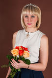 Pretty girl with bouquet roses Royalty Free Stock Photography