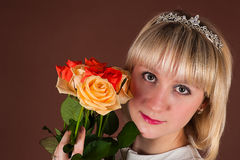Pretty girl with bouquet roses Stock Photography
