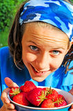 Pretty girl with bowl of strawberries Royalty Free Stock Photo