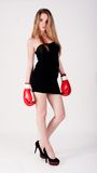 Pretty girl with boxing gloves Royalty Free Stock Images