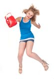 Pretty girl in boxing gloves in jump Stock Photography