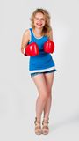 Pretty girl with boxing gloves Stock Images