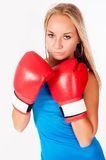 Pretty girl with boxing gloves Stock Photography