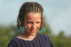 Pretty girl with braids in hair on beach Royalty Free Stock Images
