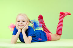 Pretty girl in bright clothing or fancy dress. Cute girl in bright clothing or fancy dress Royalty Free Stock Image
