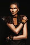 Pretty girl in brown accessories in dark. In studio Royalty Free Stock Photo
