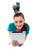Pretty girl browsing on her tablet pc Royalty Free Stock Photo