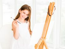Pretty girl with brush in hand Royalty Free Stock Image