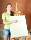 Pretty girl with brushes Royalty Free Stock Image
