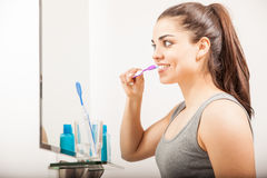 Pretty girl brushing her teeth in the morning Royalty Free Stock Images
