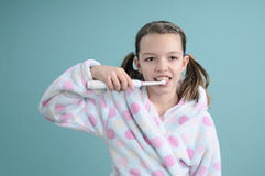 Pretty girl brushing teeth Stock Photos