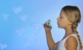 The pretty girl with bubbles heart Royalty Free Stock Images