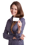 Pretty girl with business card in hand. On white background Royalty Free Stock Image
