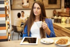 Pretty girl in cafeteria Royalty Free Stock Photos
