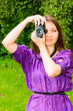 Pretty girl with camera Royalty Free Stock Photography