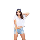 Pretty girl in cap looking at the camera Stock Images