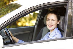 Pretty girl in a car Stock Images