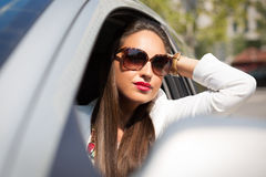 Pretty girl in a car Royalty Free Stock Photos
