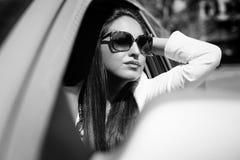 Pretty girl in a car Stock Photo