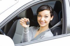 Pretty girl in a car showing the key Royalty Free Stock Images