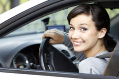 Pretty girl in a car. Pretty smiling girl in a car Royalty Free Stock Photo