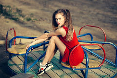 Pretty girl on carousel Royalty Free Stock Images