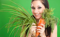 Pretty girl with carrot and onion Stock Photography