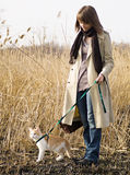 Pretty girl with cat. Pretty girl in light coat and jeans with cat in steppe Royalty Free Stock Photography