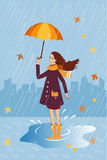 Pretty girl with a cat in pocket under umbrella. Rain background Royalty Free Stock Photo