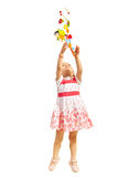 Pretty girl catching toys Royalty Free Stock Image