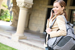 Pretty Girl on Cell Phone at School Royalty Free Stock Photos